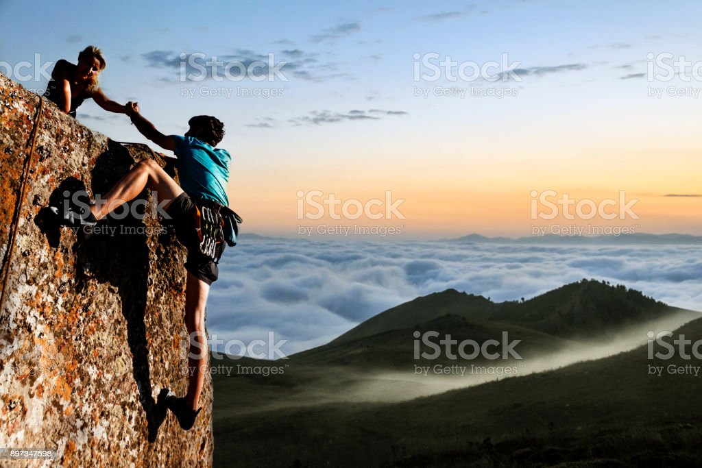 Helping hikers stock photo