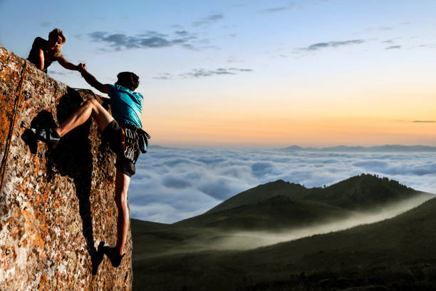 helping hikers - clambering stock photos and pictures