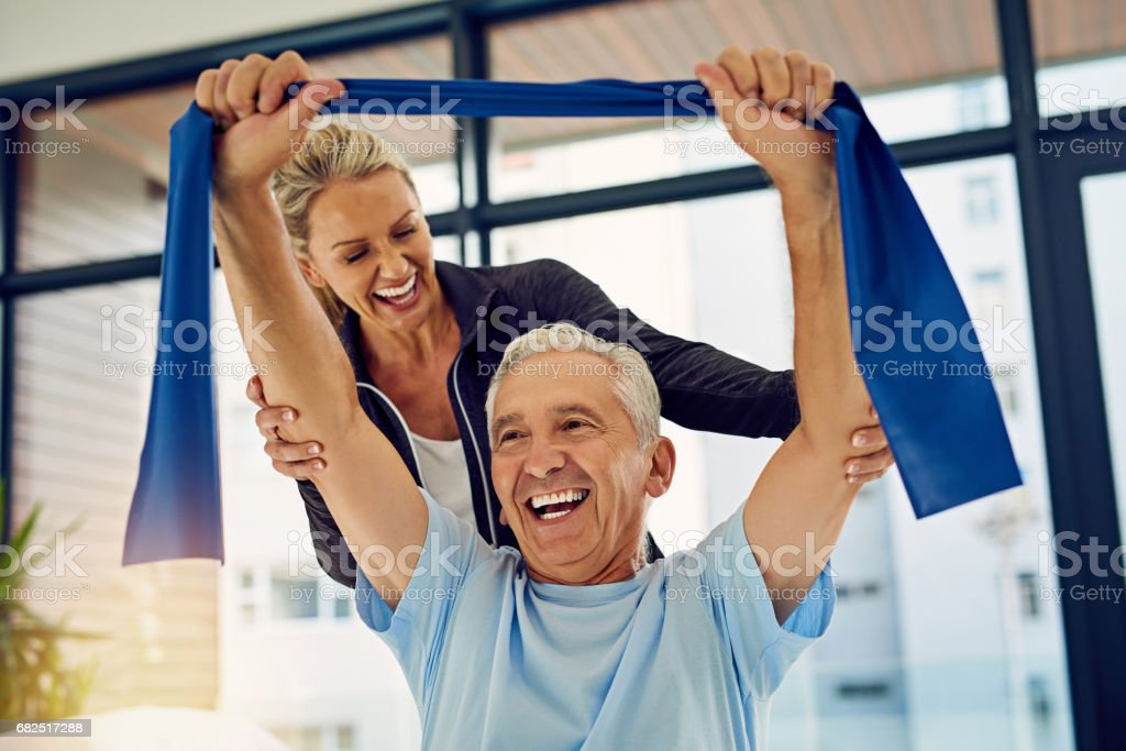 Helping him achieve great progress stock photo