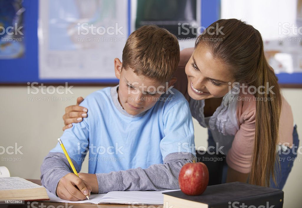 Helping him to write his own future royalty-free stock photo