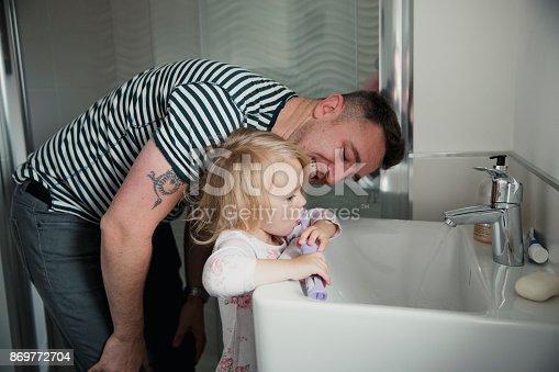 684029036istockphoto Helping His Daughter Brush Her Teeth 869772704