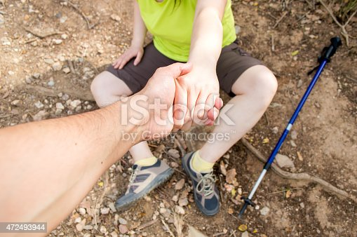 istock helping in the mountain 472493944