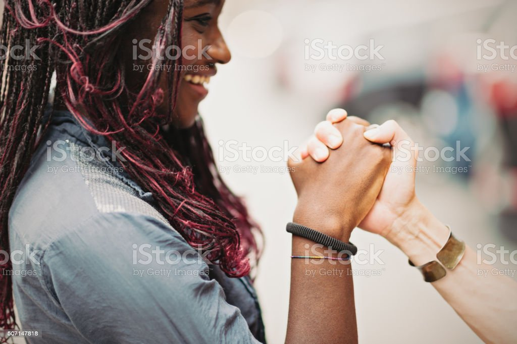 Helping mixed race female hands stock photo