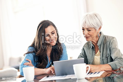 istock Helping mom with some of her home finances 861202248