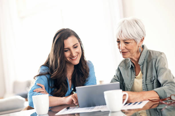 Helping mom with some of her home finances stock photo