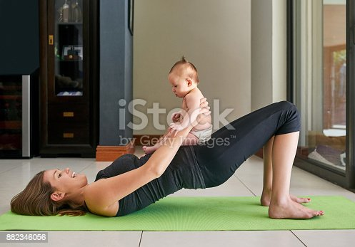 istock Helping Mommy get fit 882346056