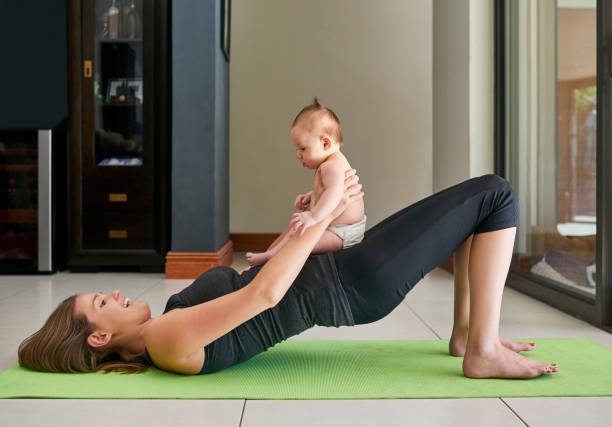 Helping Mommy get fit stock photo