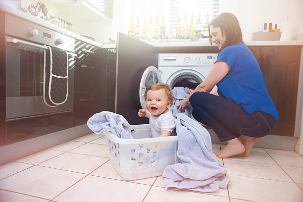 helping mummy - laundry laundry room stock pictures, royalty-free photos & images