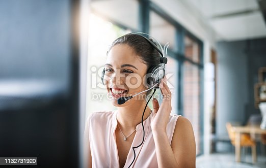 Cropped shot of an attractive young woman working in a call center