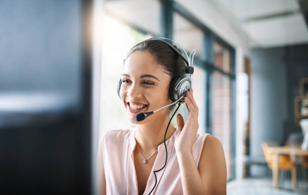 Helping others comes naturally Cropped shot of an attractive young woman working in a call center one young woman only stock pictures, royalty-free photos & images