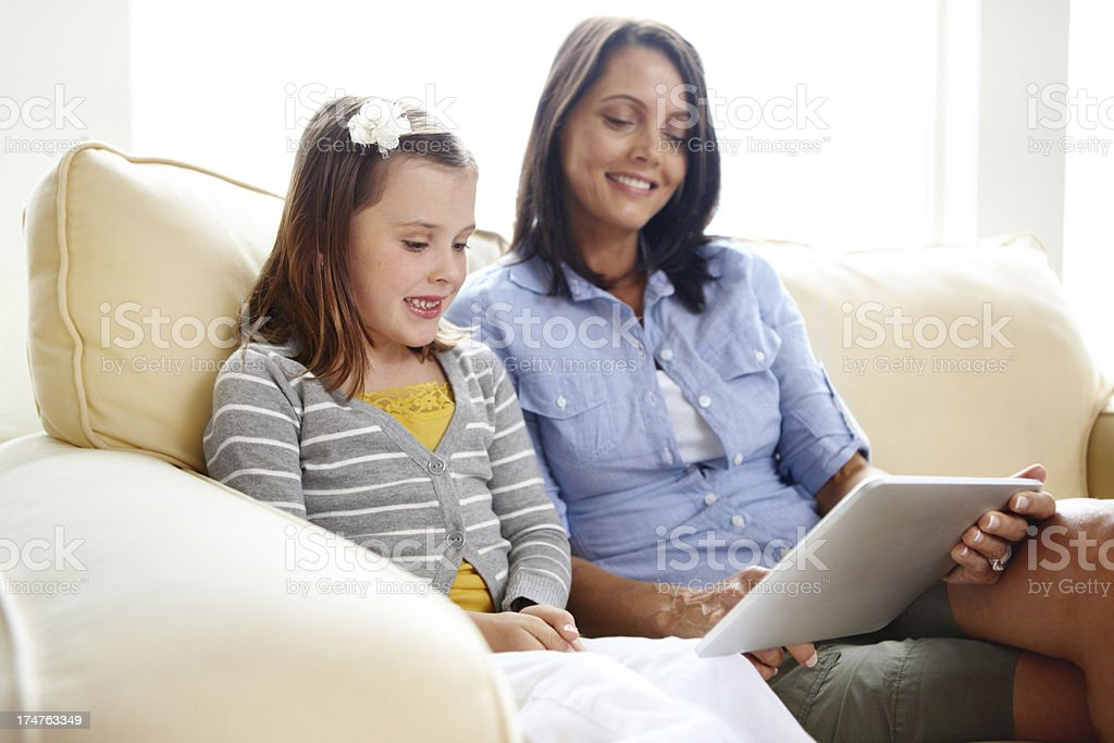 Helping out with her daughter's schoolwork royalty-free stock photo
