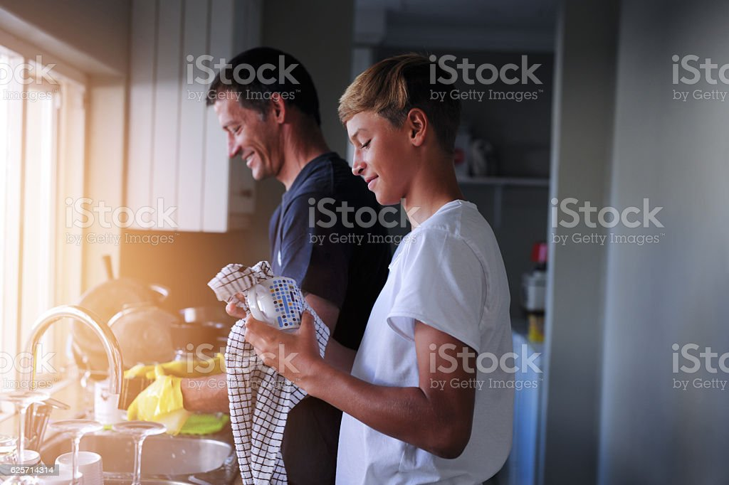 Helping out with household chores royalty-free stock photo