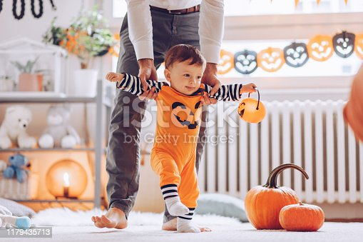 istock Helping son to make his first steps 1179435713