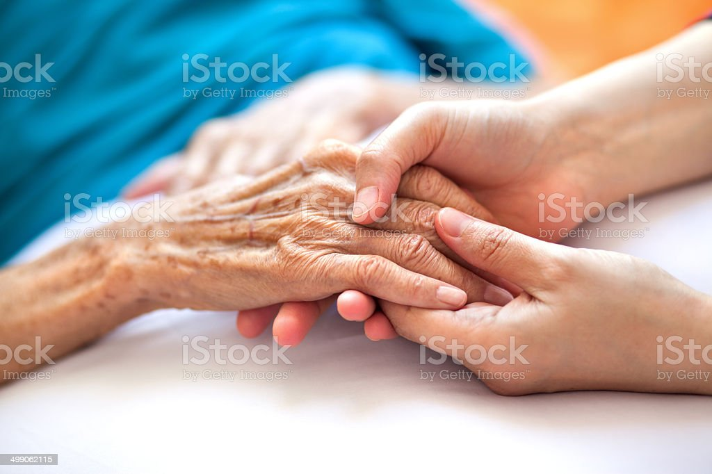 Helping the needy stock photo