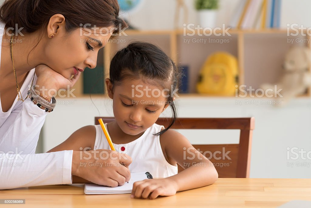 Helping with homework stock photo