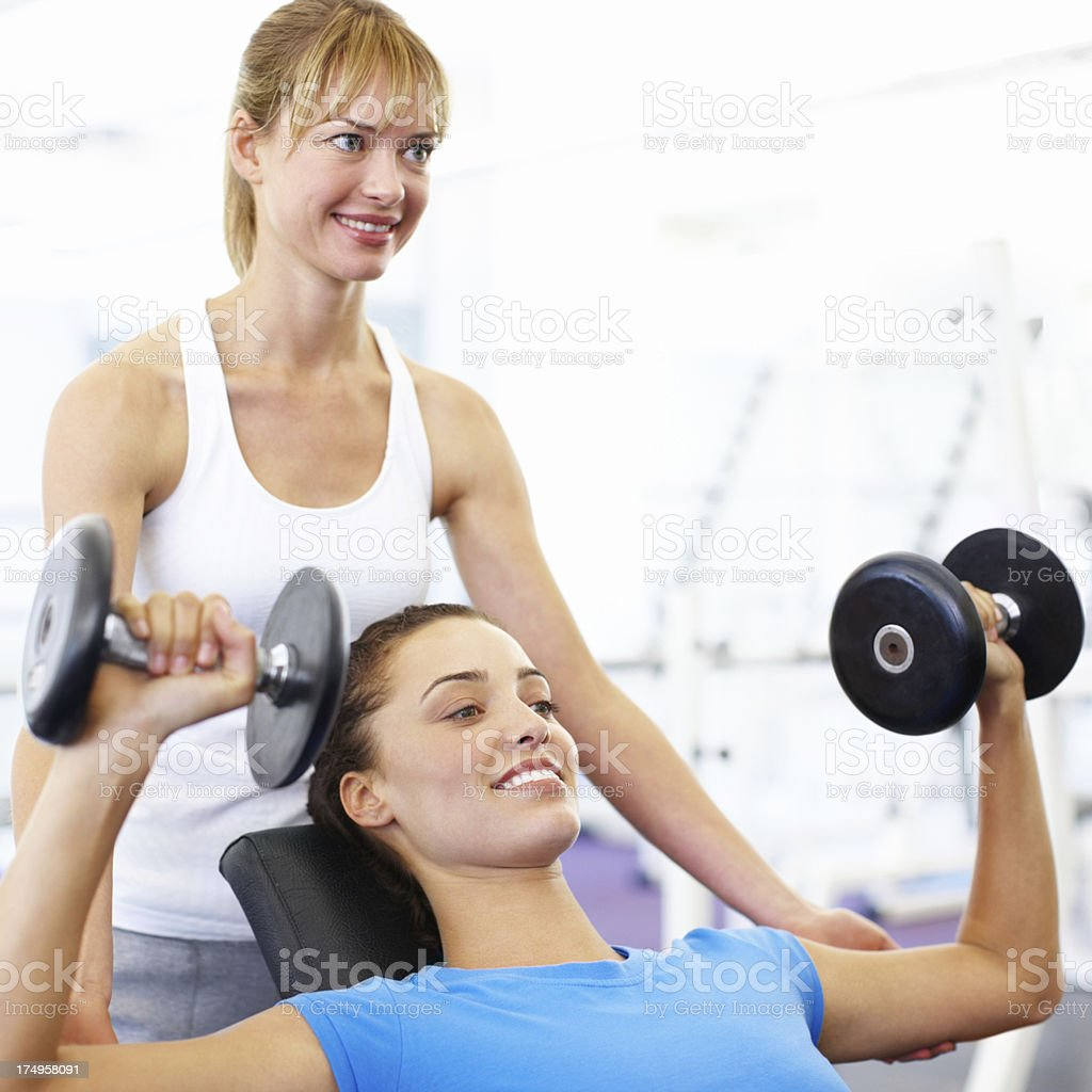 Helping young women achieve their fitness goals royalty-free stock photo