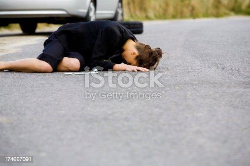 104275470istockphoto Helpless businesswoman stuck on a road 174667091