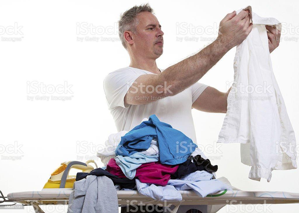 helpless man at a ironing-board royalty-free stock photo