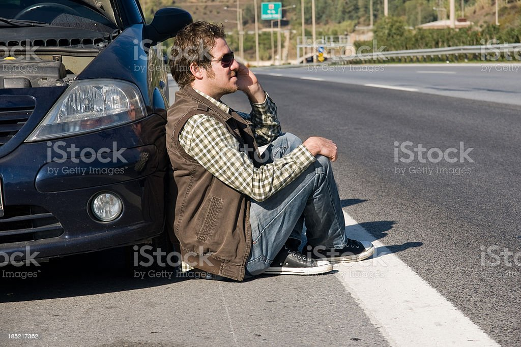 helpless man beside his car royalty-free stock photo