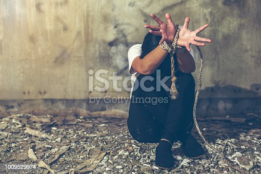 istock Helpless young woman hands tied with rope, Missing kidnapped, Hostage, human trafficking and violence concept 1009529974