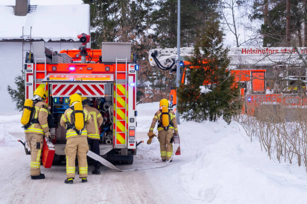 Helsinki / Finland - FEBRUARY 19, 2021: Helsiki City fire and rescue department responding to the residential structure fire. stock photo