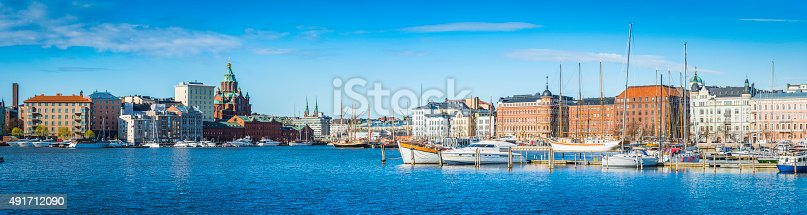 The iconic domes of Uspenski Cathedral and the historic villas of the Katajanokka neighbourhood overlooking the yachts moored in the blue waters of the Pohjoissatama north harbour in the heart of Helsinki, Finland's picturesque capital city. ProPhoto RGB profile for maximum color fidelity and gamut.