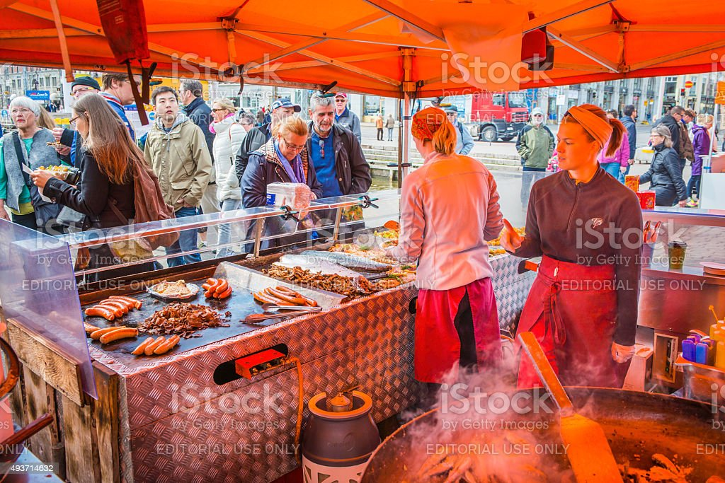 Helsinki cooks and customers at street market food stall Finland stock photo