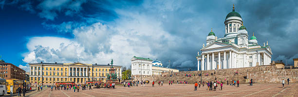 Helsinki crowds tourists Senate Square Helsinki Cathedral University panorama Finland stock photo
