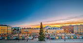 Helsinki, Finland. Christmas Xmas Market With Christmas Tree On Senate Square In Sunset Sunrise Evening Illuminations.