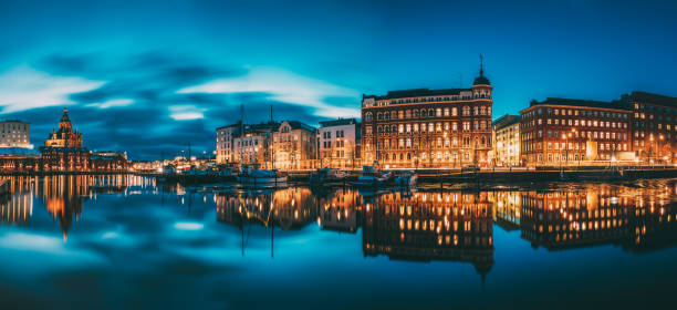 Helsinki, Finland. Panoramic View Of Kanavaranta Street With Uspenski Cathedral And Pohjoisranta Street In Evening Night Illuminations stock photo