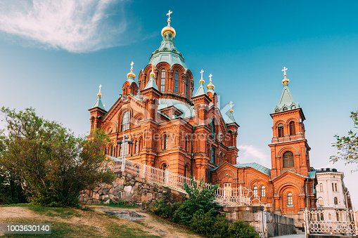 Helsinki, Finland. Uspenski Orthodox Cathedral Upon Hillside On Katajanokka Peninsula Overlooking City. Church Of Red Brick In Summer Sunny Day, Popular Tourist Sightseeing