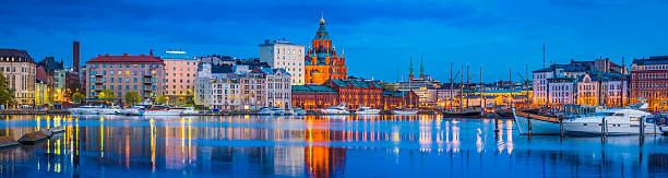 helsinki harbour uspenski cathedral yacht marina illuminated at dusk finland - finland stock pictures, royalty-free photos & images