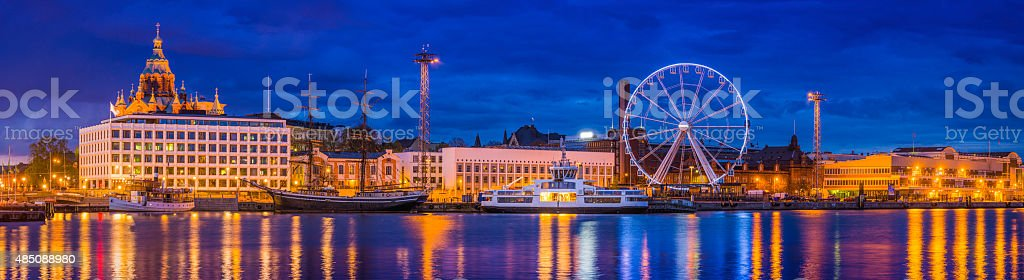 Helsinki harbour waterfront panorama Uspenski Cathedral and ferris wheel Finland stock photo