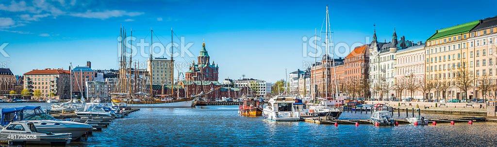 Helsinki Uspenski Cathedral overlooking waterfront villas yacht marina harbour Finland stock photo