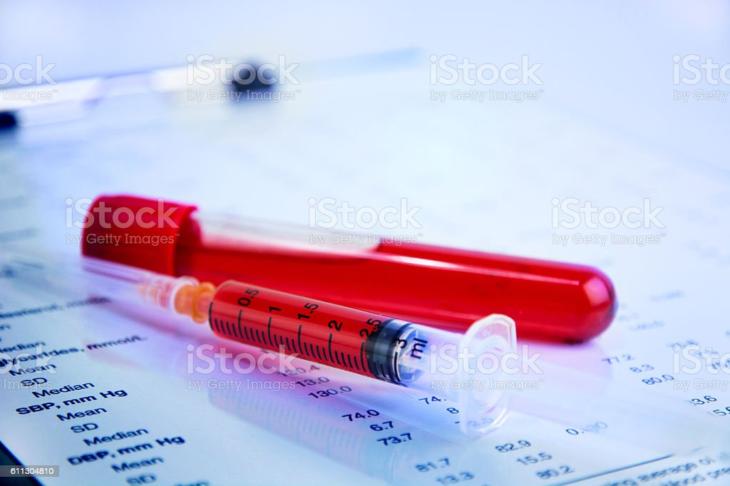 Hematology blood analysis report with blood sample collection tubes stock photo