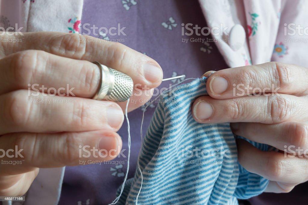 hemming a dress, woman hands needlework stock photo