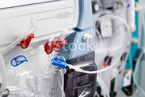 Hemodialysis bloodline tubes connected to hemodialysis machine. Health care, blood purification, kidney failure, transplantation, medical equipment concept.