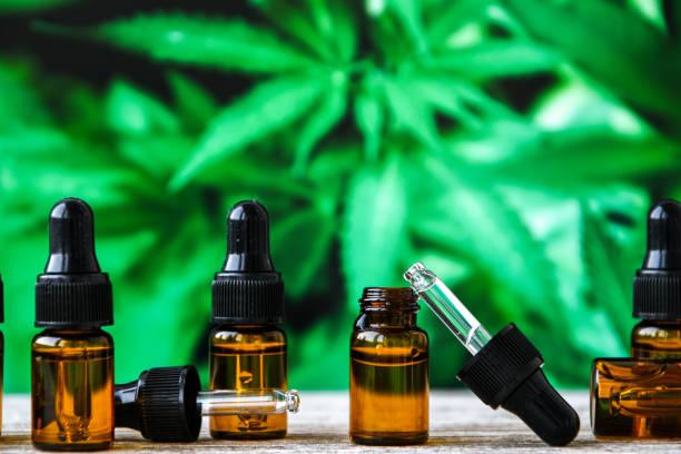 Hemp CBD oil pipette, marijuana oil bottle, cannabis extracts in jars, medical marijuana, alternative medicine. stock photo