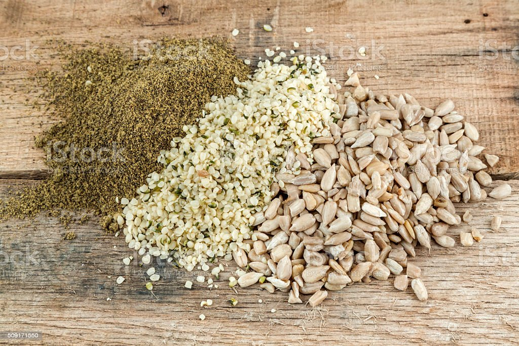 Hemp flour, Hemp seed and sunflower seeds stock photo