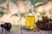 Hemp oil, Marijuana oil bottle, cannabis oil extracts in jars, medical marijuana, CBD oil pipette.