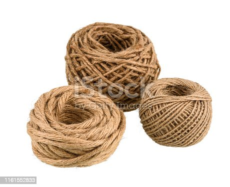Group of different size hemp rope winded is a ball isolated on white background with clipping path