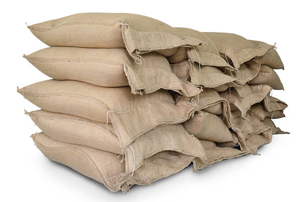 Hemp sacks containing rice Hemp sacks containing rice isolate on white background rice cereal plant stock pictures, royalty-free photos & images