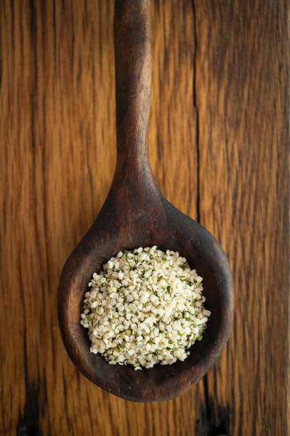 Hemp Seeds in a Hand Carved Wooden Spoon stock photo