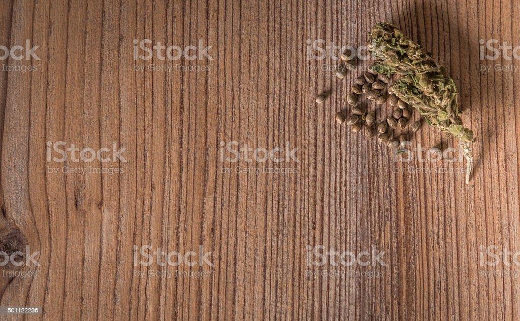 hemp seeds on wood background stock photo