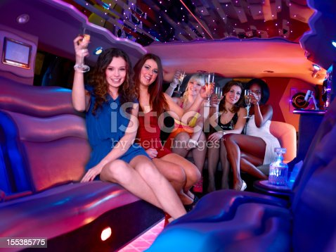 Group of young woman partying in a limo