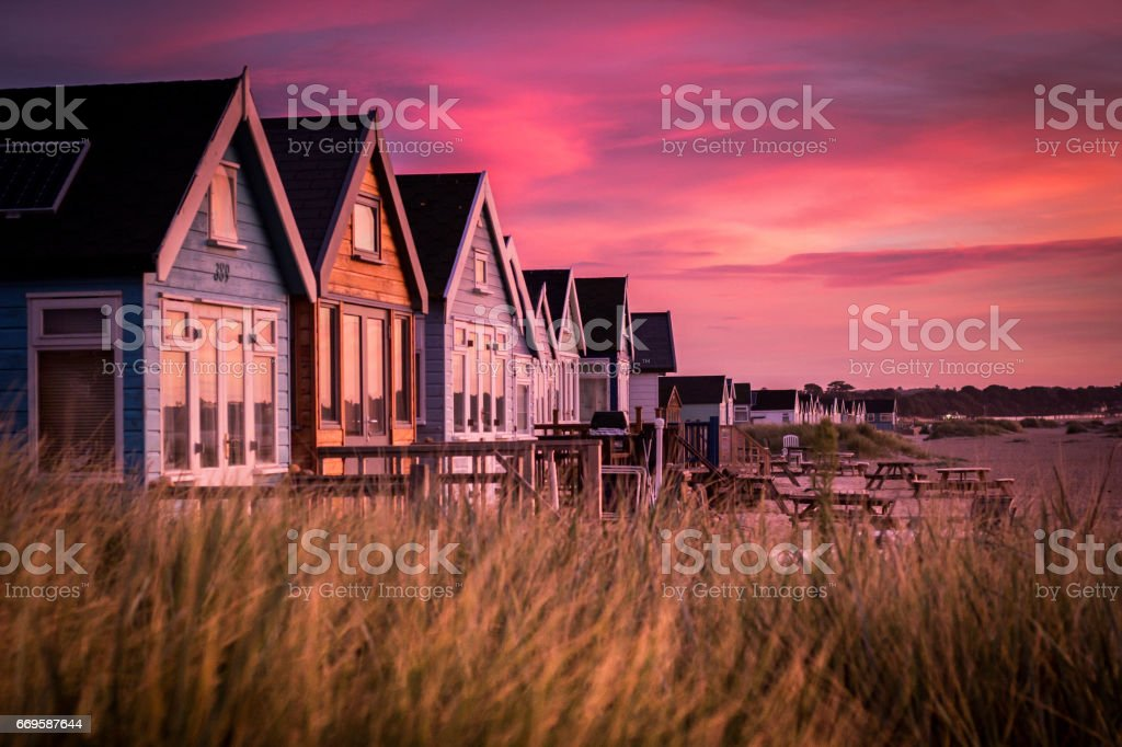 Hengistbury Head Beach Huts at Sunrise stock photo
