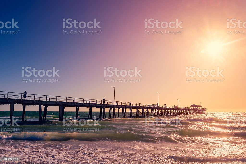 Henley Beach Jetty with people at sunset stock photo