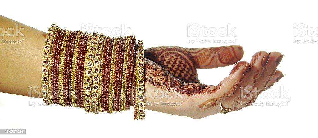 Henna(Mehandi) and bangles - Indian Bride's hand royalty-free stock photo