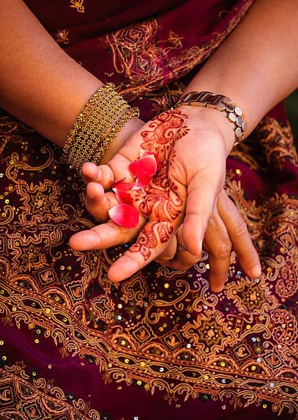 Henna and rose petals stock photo
