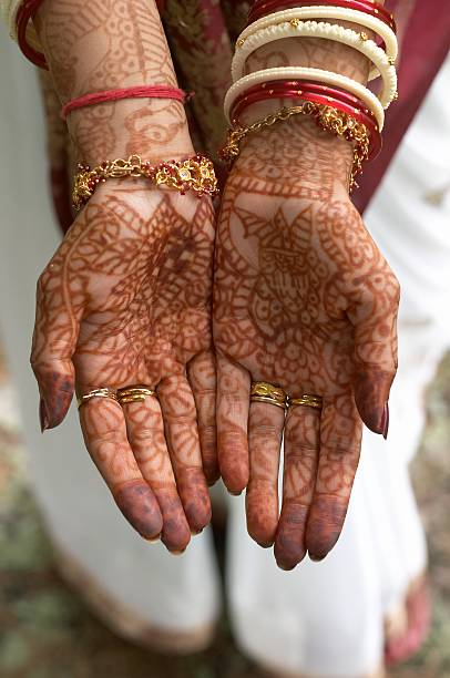Henna design on hands of bride from India stock photo